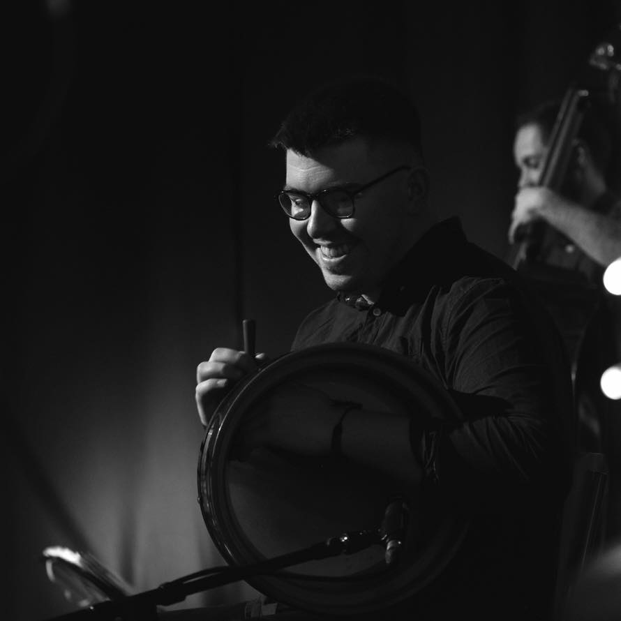 young man playing the bodhran